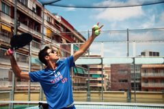 Man training padel on the court. stock images