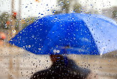 Man With Blue Umbrella Stock Images