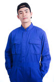 Man in blue uniform suit wearing a hat and pose acting in portra Royalty Free Stock Images