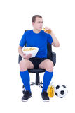Man in blue uniform watching football and drinking beer isolated Royalty Free Stock Photo