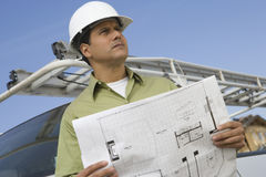 Man With Blueprint Looking Away Stock Images