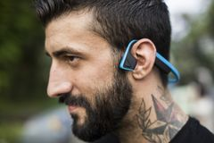 A man with bluetooth headphones Stock Images