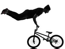 Man bmx acrobatic figure silhouette Stock Photos