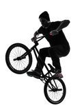 Man bmx acrobatic figure silhouette. One caucasian man exercising bmx acrobatic figure in silhouette studio isolated on white background Stock Photography