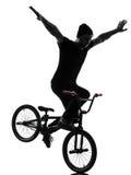 Man bmx acrobatic figure silhouette Stock Image