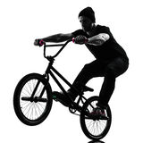 Man bmx acrobatic figure silhouette Royalty Free Stock Photos