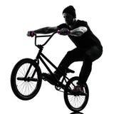 Man bmx acrobatic figure silhouette Royalty Free Stock Photos