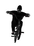 Man bmx acrobatic figure silhouette Royalty Free Stock Images
