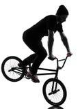 Man bmx acrobatic figure silhouette Stock Photos