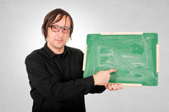 Man with board. Man holding school board and pointing the finger Stock Photo