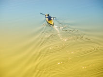 Man in a boat. The lonely person / man in a boat in the middle of the river Stock Image