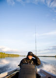 Man on boat. Male out with his boat on a calm water lake, for some fishing Stock Image
