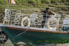 Man on the boat. The man on the bow of the vessel , Ayeyarwady River in Myanmar (Burma Royalty Free Stock Photo