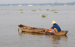 A man with the boat on Cai river in Mekong Delta, Vietnam Stock Photo