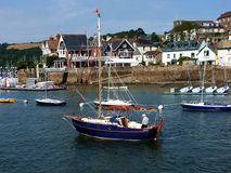 Man on a boat, Darmouth, Devon, UK Royalty Free Stock Images