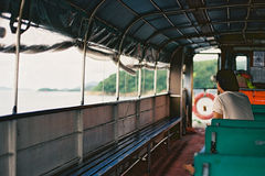 A man in a boat. Boat ferry hongkong man afternoon free lake island in a daze royalty free stock images