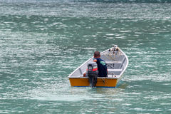 Man in boat Stock Photography