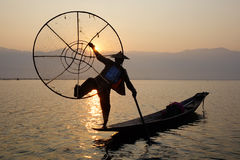 A man with boat on Inlay lake in Shan, Myanmar Stock Images
