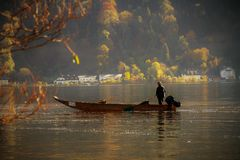 Man in boat on lake or river Stock Image