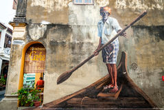 Man in boat with oar. Street art, George town Royalty Free Stock Photo