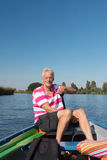 Man in boat at the river. Elderly man in boat at the river royalty free stock images