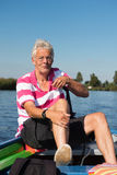 Man in boat at the river. Elderly man in boat at the river royalty free stock photos