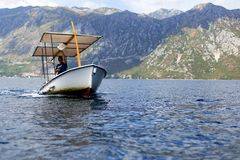 The Man on the boat sails with tourists,editorial royalty free stock image