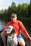 The man in the boat with the setter. Shores of Tagasuk lake. Royalty Free Stock Photos