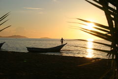 Man on the boat at sunset. A man standing on a boat in sunset (Venezuela, Caribbean sea royalty free stock photo