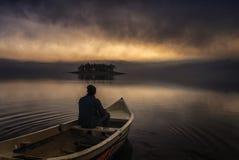 Man on boat Stock Image