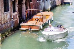 Man with boat in Venice , Italy Royalty Free Stock Photo