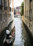 Man on a boat in Venice Royalty Free Stock Image