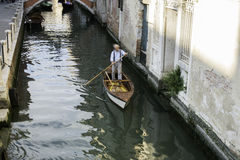 Man on a boat in Venice Stock Photo
