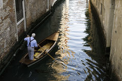 Man on a boat in Venice Royalty Free Stock Photo