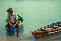 A man and boat. A man waiting customer to rent his boat at Pari island Jakarta indonesia Stock Photos