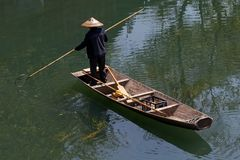 Fenghuang - man on the boat royalty free stock image