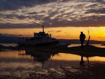 Man and a boats in sunset Royalty Free Stock Photography