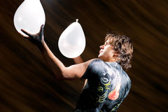 Man and body art with balloons Stock Images