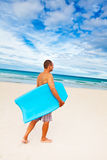 Man with body board Stock Images