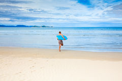 Man with body board Stock Image