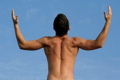 Man with a body builder. Back xpressing freedom stock photography