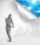 Man in body suit escaping from city to nature concept Stock Photo