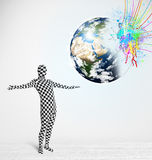 Man in body suit looking at colorful splatter 3d earth, Elements of this image Royalty Free Stock Image