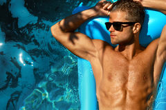 Man Body In Summer. Male Relaxing In Pool On Vacation Royalty Free Stock Photo