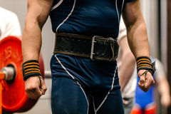 Man body weightlifter. Belt for lifting and wrist wraps powerlifting Royalty Free Stock Photo