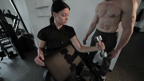 Man trainer trains a woman. stock video