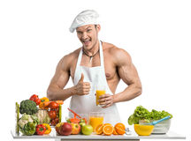 Man bodybuilder cook Stock Image