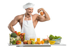 Man bodybuilder cook Stock Image