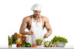 Man bodybuilder cook Stock Images