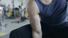 Man bodybuilder execute exercise with dumbbells in gym. No face stock footage